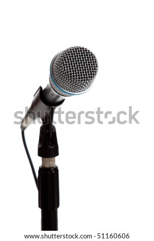 A white microphone on a white background with copy space