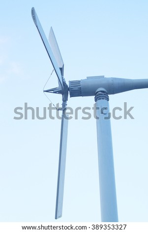 A Wind turbine(windmill) over blue sky with sun light, BangPoo ,Thailand