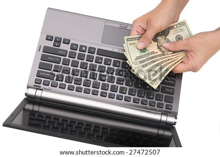 A woman counts her cash while shopping on the Internet