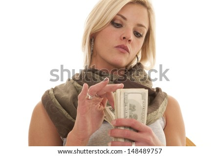 A woman flipping through a stack of money.