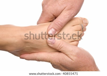 A woman getting a foot massage by a man.