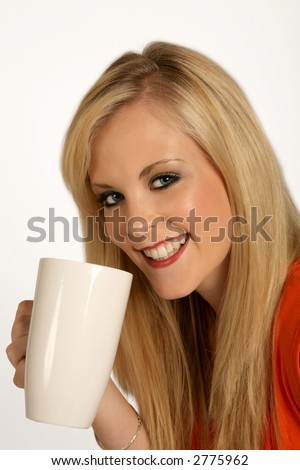 a woman holding a coffee mug in her hand