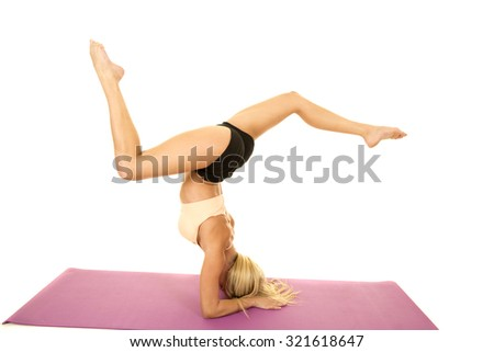 woman doing headstand on yoga mat stock photo 7021867