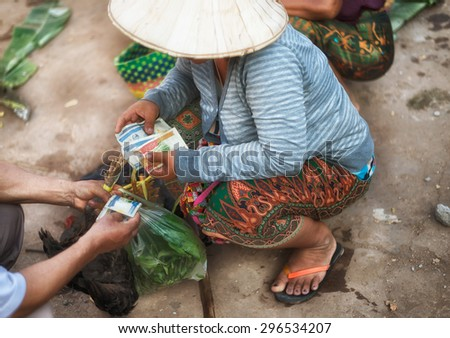 A woman monger in the marketplace at Pakse city, south of Laos