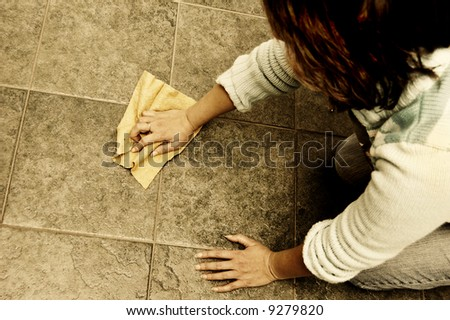 a woman scrubbing the floor at home