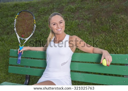 A woman tennis player having fun to play this game.