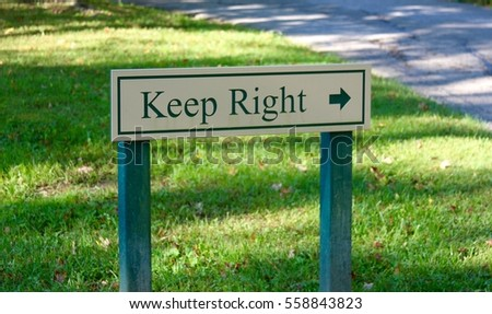 A wooden keep right sign.