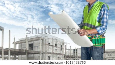 Construction worker man all tools supplies stock photo 759368977 a worker man with all of tools supplies holding construction plan blueprint ready for check and malvernweather Image collections