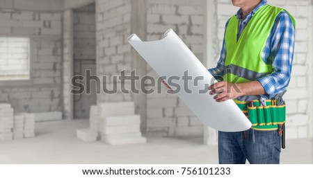 Worker man all tools supplies holding stock photo 697209787 a worker man with all of tools supplies holding construction plan blueprint ready for check and malvernweather Image collections