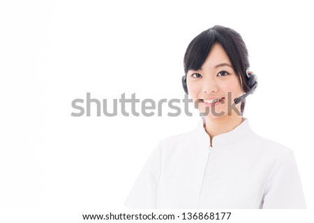 a young asian nurse with headset on white background