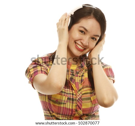 A young beautiful woman with headphones on white background