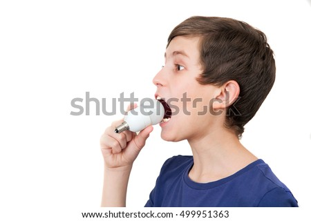 A young boy is trying to swallow an electrical lamp