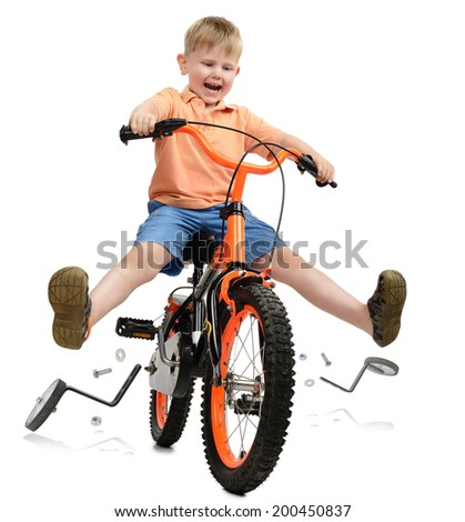 a young boy learning to ride and breaking free from training wheels all isolated on a white background