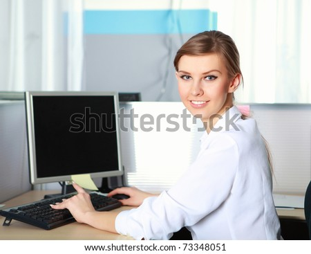 a young business woman at her workplace in the office