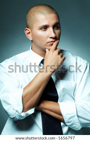 A Young businessman with tie and white shirt