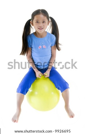 A young child on a bouncing ball. Isolated on white