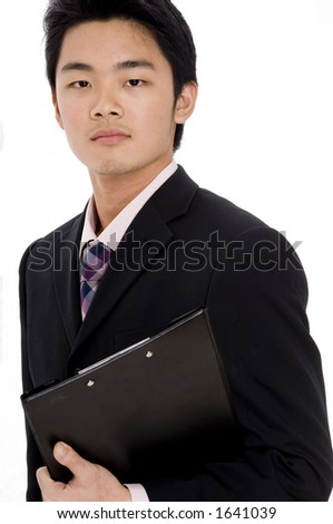 A young chinese businessman in suit on white background