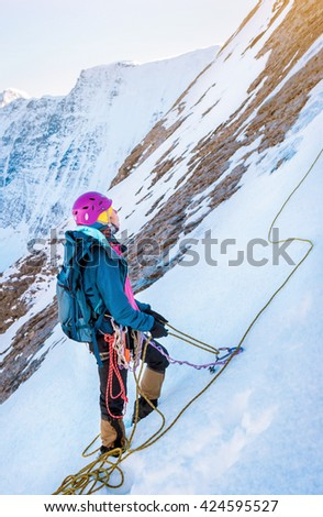 A young climbers reaching the summit. Extreme sport concept