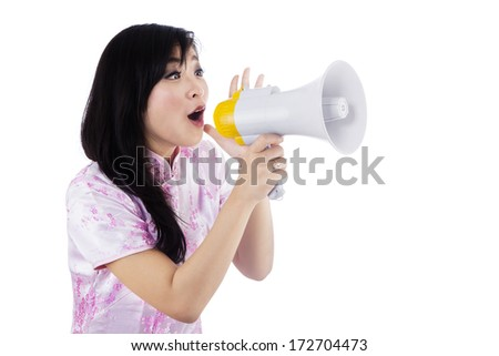 A young girl announcing chinese new year with megaphone