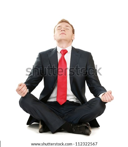 A young guy sitting on the floor, isolated on white background