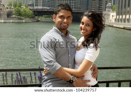 A young happy couple on a bridge.