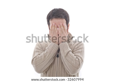 a young man his hidding his face with both hands