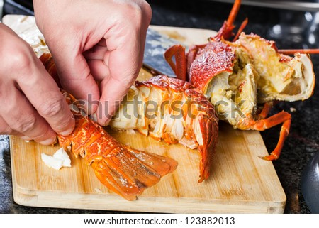 A young man is preparing and cleaning the crayfish.