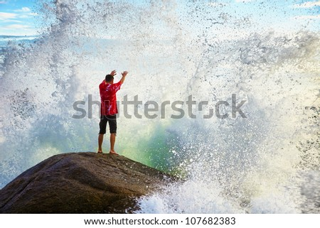 A young man prays sea elements