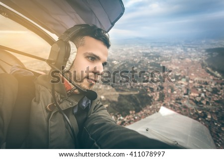 a young pilot in sightseeing flight above Brasov city having best conditions for flying