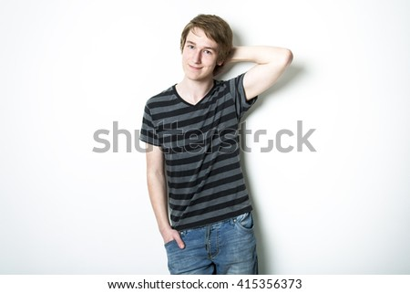 A young teenage boy being photographed in a studio.