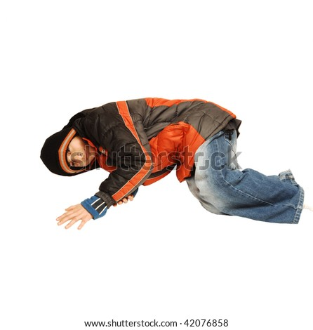 A young teenager boy is laying on the floor in winter cloths  having fun, on white background.