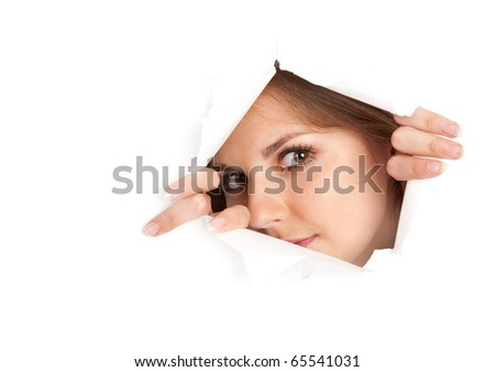 a young woman is looking through a window is made from paper. isolated on white background