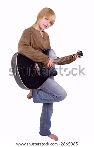 A young woman playing her guitar with expression.