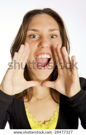 A young woman screaming with her hands near her mouth