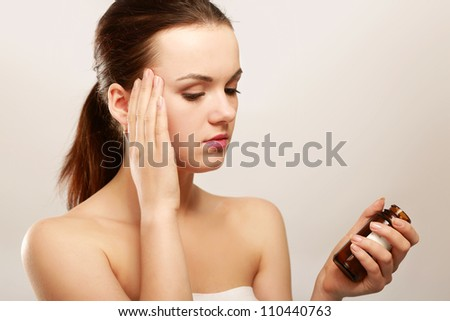 A young woman taking pills