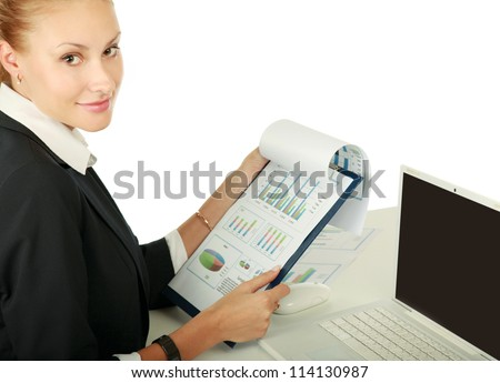 A young woman with a laptop sitting isolated on white background