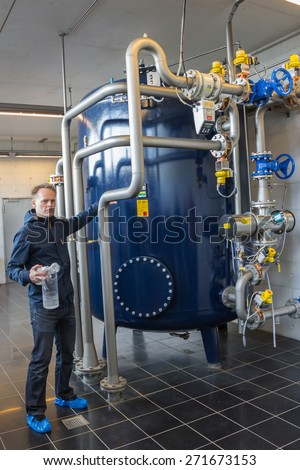 AARHUS, Denmark - April 13, 2015: A guide giving a tour around a water plant in Aarhus