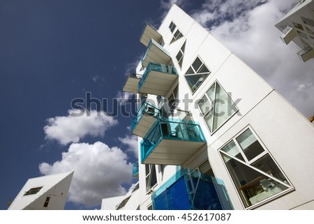 AARHUS, DENMARK - JULY 13, 2016: New modern architecture on Aarhus harbor. The buildings called The Iceberg. Aarhus will be European capital of culture in 2017. July 13, 2016.