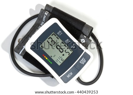 Above view of blood pressure monitor cuff and pipe on white background