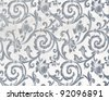 Abstract background of a heavy grey brocade fabric with interwoven repeat design. - stock photo