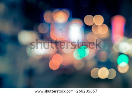 Abstract background of bokeh light at city night with vintage color tone tuned