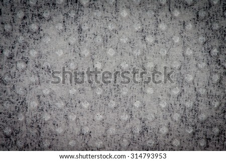 Abstract background of grunge dotted paper texture.