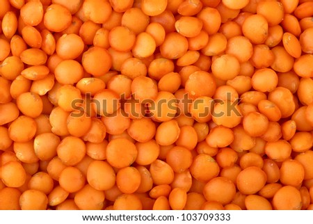 "Abstract background: Red ""football"" lentils"