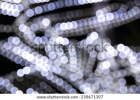 Abstract background with bokeh defocused colorful lights - image of defocused lights on the Christmas tree