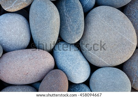 abstract background with round pebble stones in vintage retro stile.  stones beach smooth