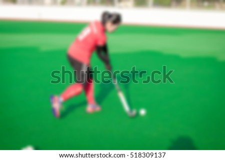 Abstract blur. Abstract blur of Hockey players on the turf. While practicing