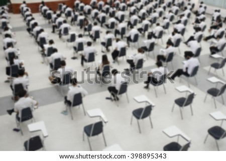 Abstract blur background of student during test and exams at university.