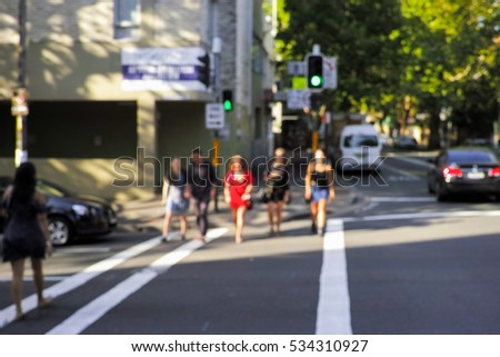 Abstract blur of people standing at traffic lights in Sydney, Australia