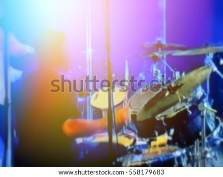 abstract blurred image. Actor drummer plays the drums. Musician plays a musical instrument on the concert stage