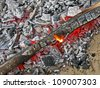 abstract bonfire with hot carmonized wooden coal, picnic details - stock photo